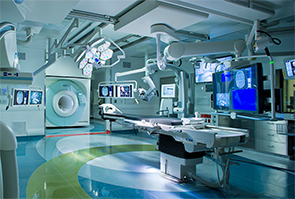 During intra-operative scanning, the MRI travels in and out of the operating room using ceiling-mounted rails to provide real-time images without moving the patient.