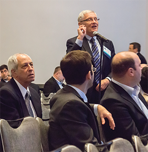 Audience members during a panel discussion.