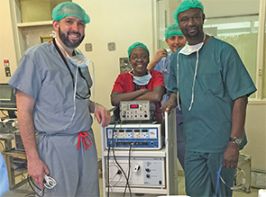 From left: Matthew Bush, MD, Catherine Irungu, MD, John Ayugi, MMED, Paul Radabaugh, MD. This donated facial nerve monitor was the first of its kind at the University of Nairobi.