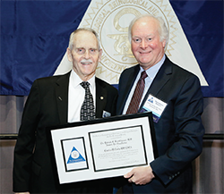 Dr. Luetje receives the Brookhouser Award from Trio President Dr. Beatty
