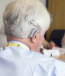 Cochlear implant in older man.