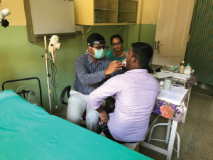Dr. Yalamanchali and laryngology fellow Dr. Kavin Kumar during outpatient clinic at St. Thomas Hospital.