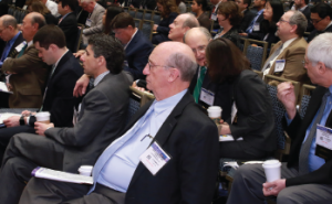 Attendees listen to a panel at the Triological Society annual meeting.