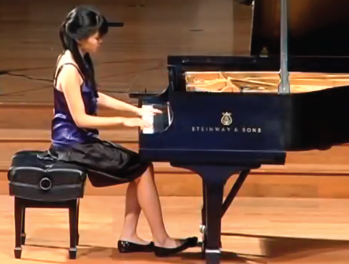 Dr. Chen at her piano.