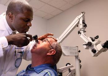 Dr. Gado with a patient.