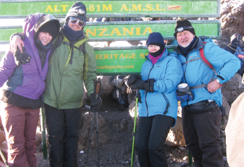 Dr. Woodson and her husband, Tom Robbins, on the right and their daughter Sarah and son Nick on left, on Mount Kilimanjaro.