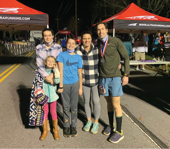 Jim Daniero, MD, celebrates with his family after completing the 2020 JFK 50 Mile race in 10 hours.