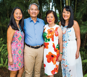 The author, Julie L. Wei, MD (left), with her parents and sister.