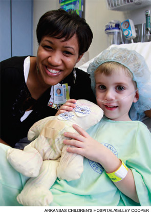 Child life specialist Cassandra James with patient Zachary Needham