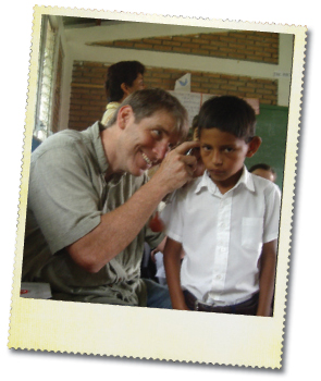 Dr. Saunders conducting a screening for ear pathology and hearing loss among children in second grade in Nicaragua