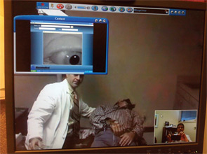 Dr. Arriaga sees telemedicine as one way to close the workforce gap. In this photo, Dr. Arriaga, who was in Pittsburgh at the time the photo was taken, is seen in the lower right corner. The patient's eye is seen in the upper left corner. Dr. Arriaga's otology fellow, Jeff Lacour, MD, stands alongside the patient in Baton Rouge, Louisiana. The patient is being evaluated for positional vertigo.