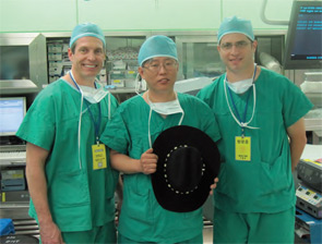 Dr. Andrew L. de Jong, left, and Dr. Ron Kuppersmith, right, of Texas ENT and Allergy in College Station, Tex, traveled to Seoul, South Korea, to observe the robotic thyroid surgery pioneered by Dr. Woong Youn Chung, center, of Yonsei University College of Medicine, who is holding the cowboy hat presented to him by the visiting surgeons