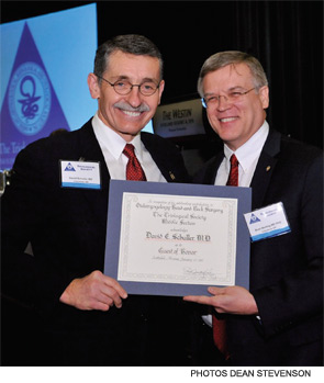 David Schuller, MD, accepting a Guest of Honor award from D. Bradley Welling, MD, PhD.