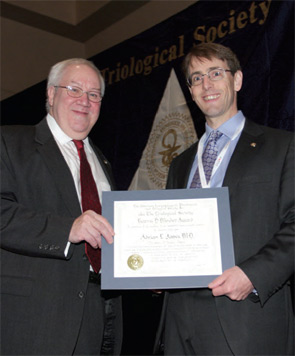 Adrian James, MD, accepts the Mosher Award