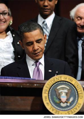 President Obama signing the health reform bill
